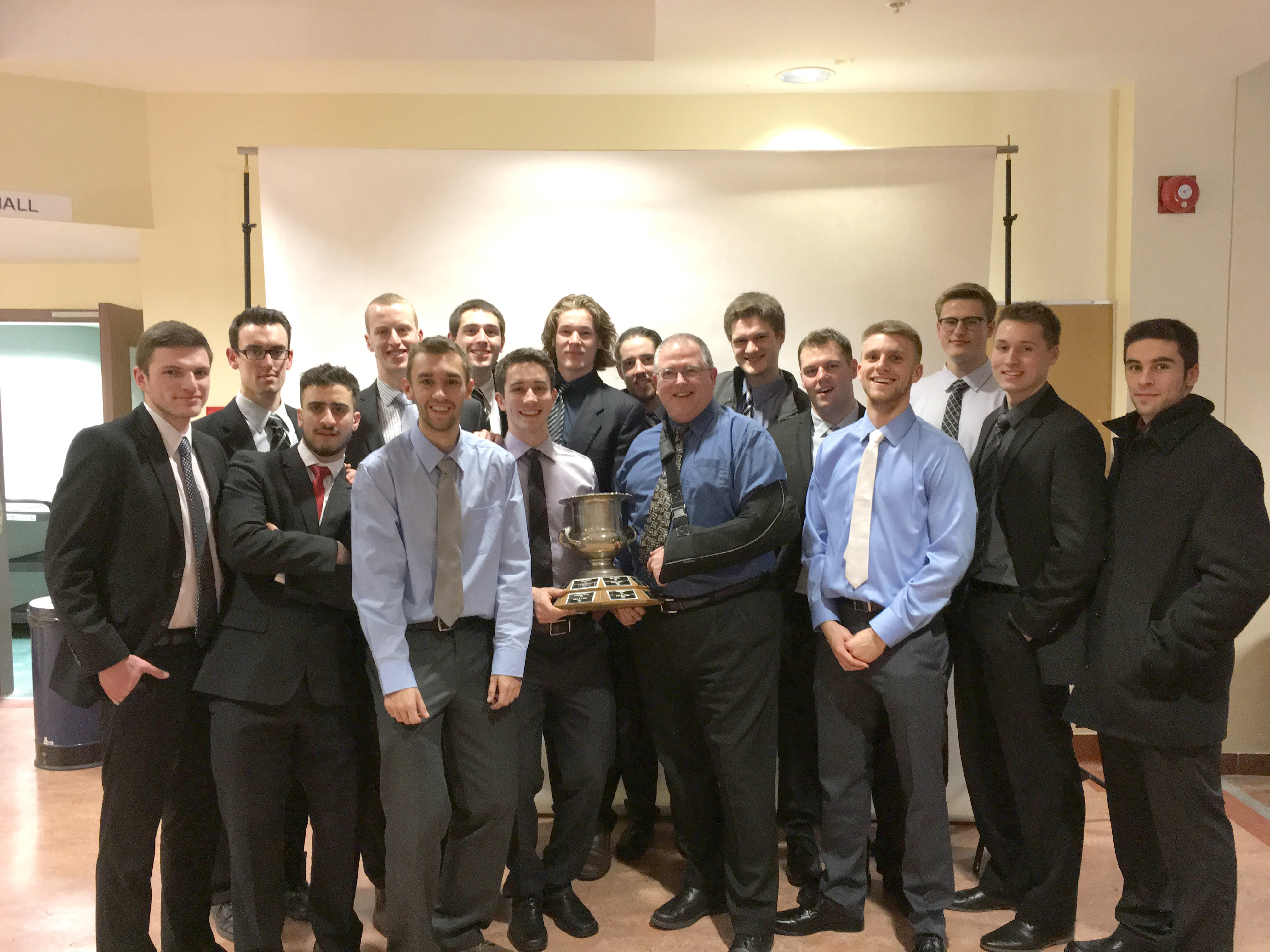 The team celebrates the wins of two of their own at the ACAA awards banquet.